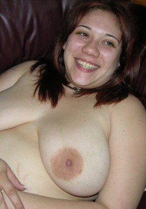 Big titted chubby amateur Monica undresses and spreads her shaved pussy