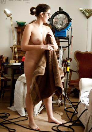 Brunette amateur Ariel D getting dressed after being nude