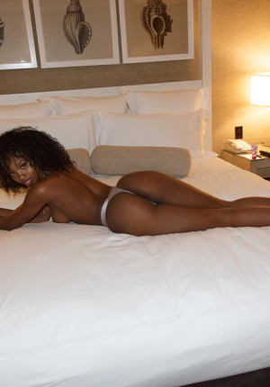 Voluptuous ebony queen Asia Amour teases with her boobs on the sofa