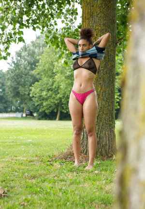 Creepy voyeur observes black damsel Whitney dressing bare bod in park