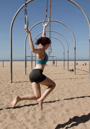 wpid-alluring-freckle-faced-redhead-sabrina-lynn-working-out-and-teasing-on-the-beach1.jpg