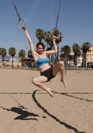 wpid-alluring-freckle-faced-redhead-sabrina-lynn-working-out-and-teasing-on-the-beach3.jpg