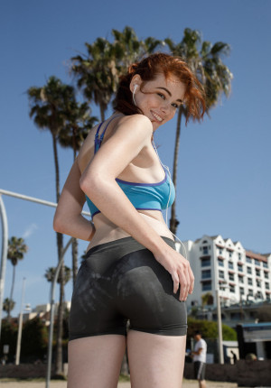 wpid-alluring-freckle-faced-redhead-sabrina-lynn-working-out-and-teasing-on-the-beach8.jpg