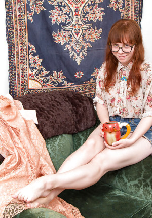 Dorky amateur redhead Carrie B removes her knickers to display her furry snatch