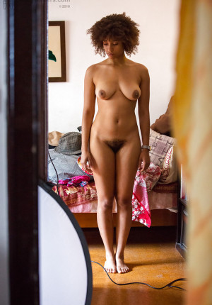 Nude ebony amateur Whitney spotted on hidden camera getting dressed