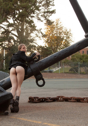 Naughty girl Gloria Paquette plays outside at dusk teasing with some public upskirt shots
