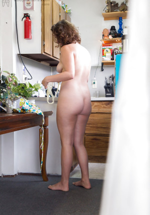 Big butt nude amateur Willa pulls on her panties and a dress in kitchen