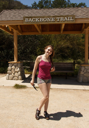 Cute freckle faced brunette Misty Lovelace goes on a hike and takes out her tits