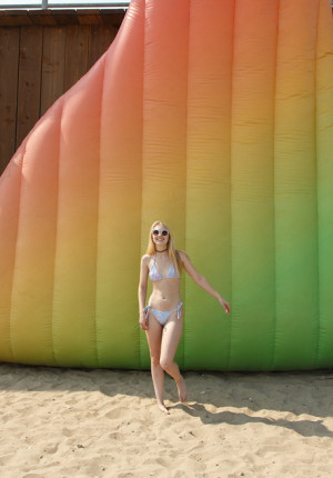 Thin blonde hottie Lily Rader playing coyly on the beach