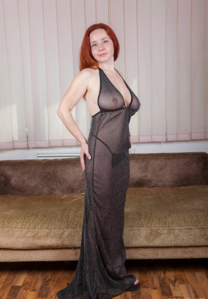 Curvy big tits redhead Sara Nikol steps out of her sheer nightgown to show her hairy pussy