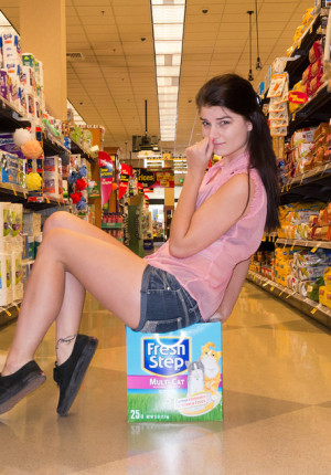 Cute brunette coed Alyson Grey teasing in a store and outside