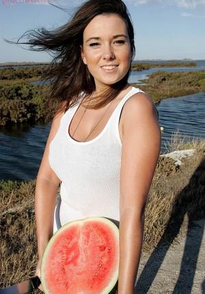 Curvaceous amateur beauty Bridgette giving a big tits show at the beach