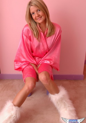 Cute perky blonde tease Madison Summers isnt a shy girl as she strips down to just her fluffy boots
