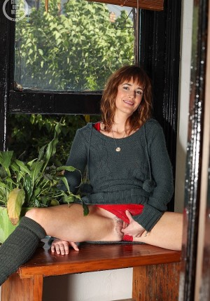 Georgia gets naked by the window and fingers her pussy in her legwarmers