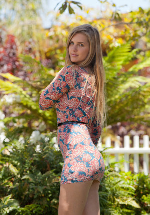 Sexy blonde coed Holly Benson lets us see up her skirt outside