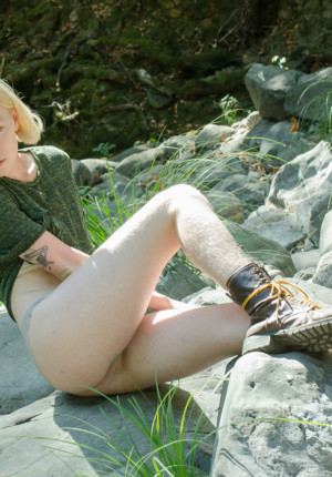 Petite blonde pixie Ivy Blair displaying her nude hairy pussy outside
