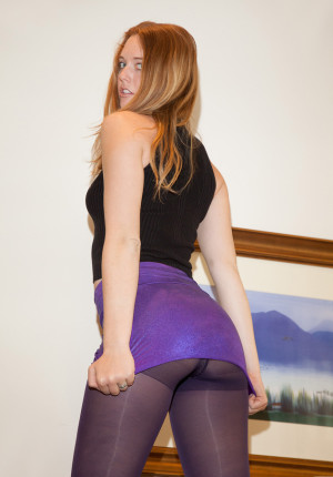 Randy young blonde Nicole Wetzel bends over in her tights and skirt