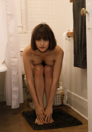 Pixie haired Basil Navas playing nude in her apartment