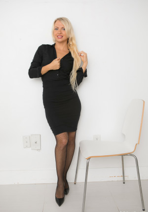 Beautiful blonde Svetlana Neery strips to her heels and stockings