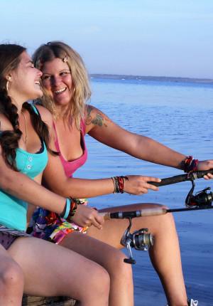 Two amateur lesbian friends play in public