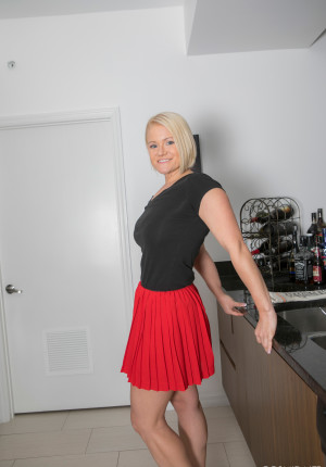 Busty and curvy blonde Katie playing in her red skirt and nude