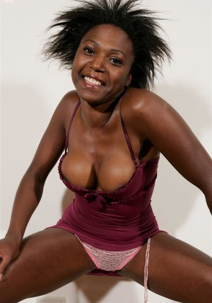 Wild haired black chick Manutela strips and shoves a toy inside
