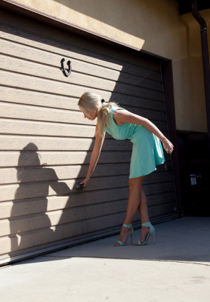 Exceptional blonde babe Claudia Quattrone teasing out by the garage
