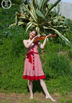 Fair skinned amateur Charly playing violin and getting naked in the grass outside