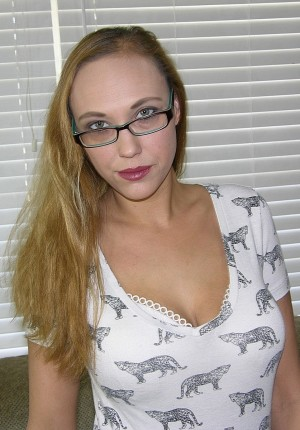 Busty blonde amateur in glasses Alexia spreads her big butt cheeks