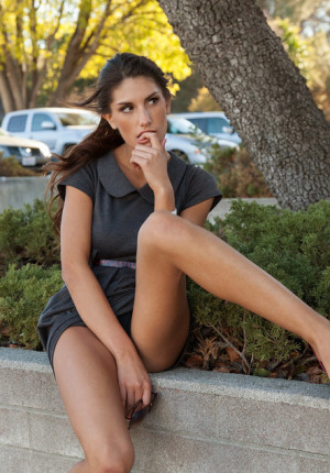 Leggy hottie August Ames lifts her skirt on the street to show her panties