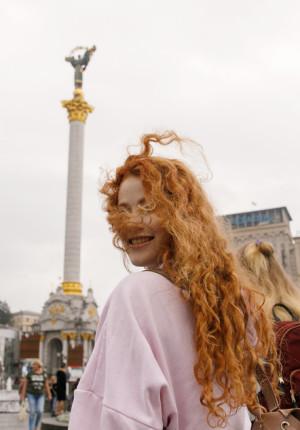 Redhead maiden Heidi Romanova flashing her tits out in public