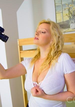 Huge breasted babe Inge teasing in her stockings and panties