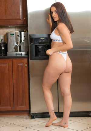 Pierced hottie Shelby Mayne spreads her butt in the kitchen
