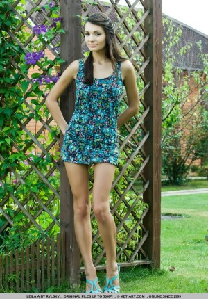 Slim beautiful young lass Leila A takes off her dress in the garden