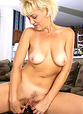 Spicey blonde MILF has fun showing off her perfect body
