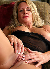 35 year old MILF in black lace fingers her mature pussy