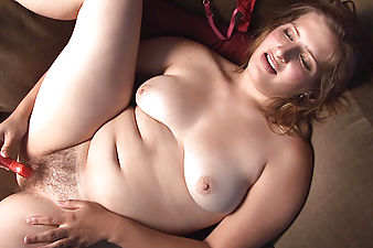 Curvy blonde Jodi shivers while flicking her clit and sliding her small vibrator in and out of her moist hairy pussy.