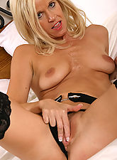 Blonde MILF has fun with a double ended dildo in here