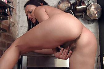 Mila Z rubs her hairy box in the kitchen