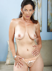 Big titted brunette MILF shows us everything she has to show