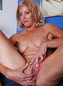 Liz slips off her thong and slides onto a dong in this picture gallery