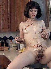 Kelly Jones gets her hairy pussy messy in this video