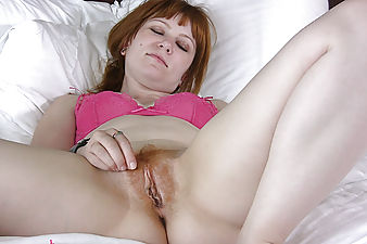 Natural redhead Iraina gives a peak at her personal side, and then slowly slides her fingers into her moist pale pussy.