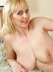 Hot busty blonde MILF plays with her tits and mature pussy