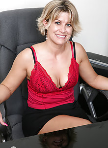 Mature secretary peels off her clothes and spreads on the desk