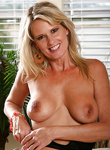 Blonde MILF Bridgette loves to finger her mature pussy in here