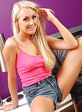 Lucy Anne shows off her shapely legs in her cropped denim hotpants and knee high socks.