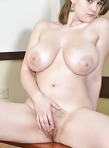 Busty hairy babe Destiny gets naked and shows her curves