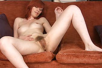 Redhead Leanne touches her hairy bush