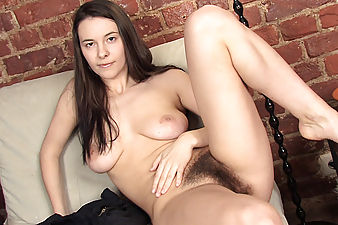 Watch Claire giggle as she gently pulls on her thick dark pussy hair as her big natural breasts bounce around in the living room. What if she gets seen?